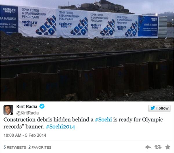 """Twitter @KiritRadia: """"Construction debris hidden behind a #Sochi is ready for Olympic records"""" banner. #Sochi2014""""  Pic: Construction debris."""