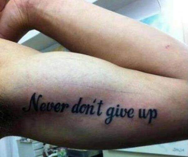 """Bad Tattoo: """"Never Don't Give Up."""""""