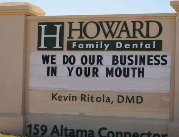 """Dentists Sign: """"Howard Family Dental: 'We Do Our Business In Your Mouth'  Kevin Ritola, DMD, 159 Altama Connector, Brunswick, GA"""